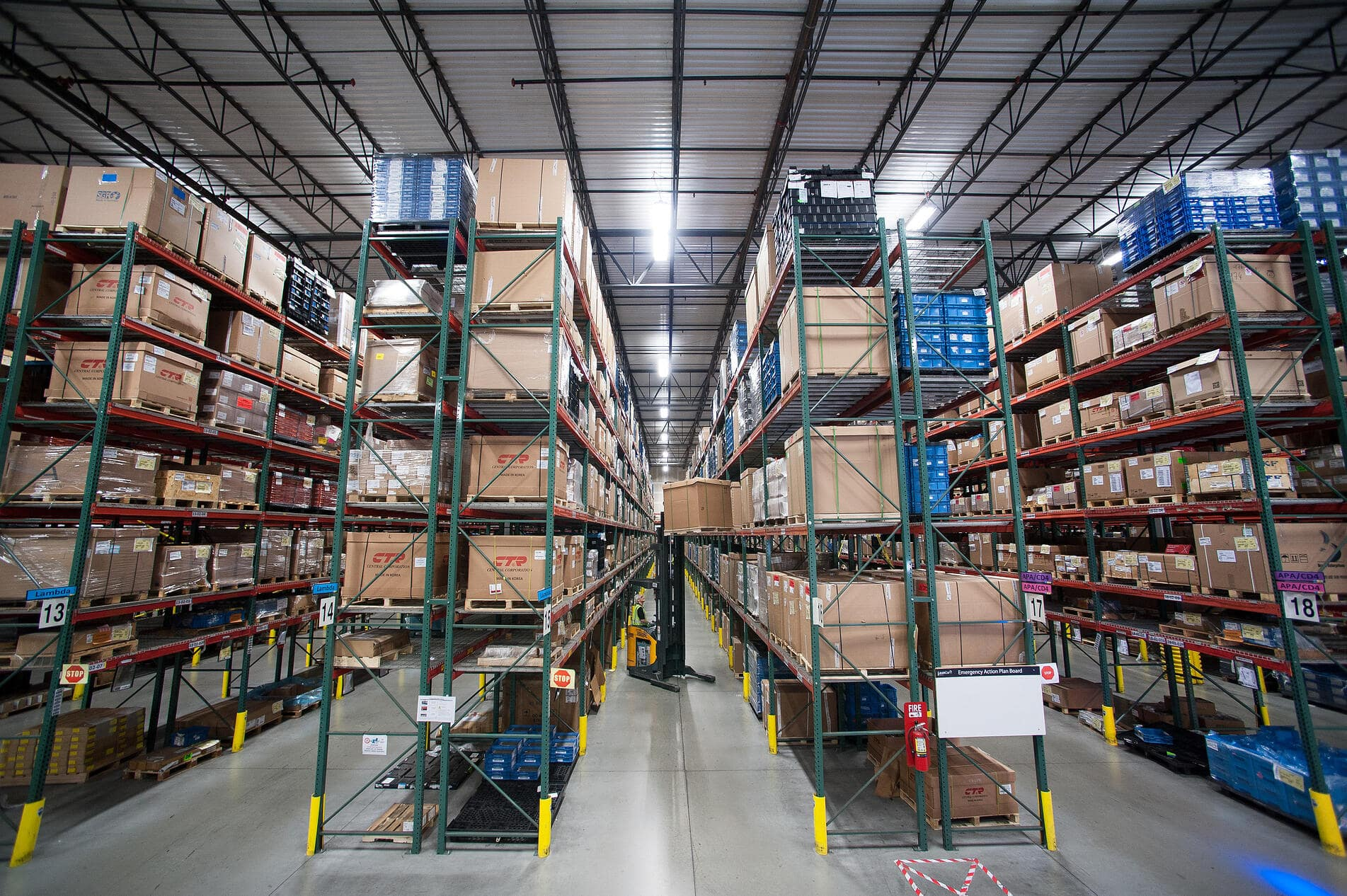 Warehouse with shelves of boxes.