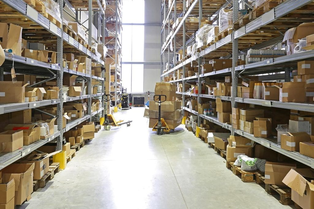 An aisle of a fulfillment center warehouse.